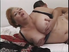 Busty mature whore screwed on her back